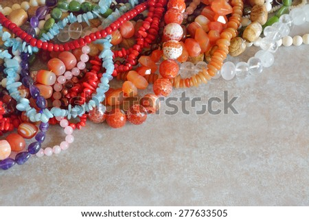 Gorgeous semiprecious stone beads for making jewelry - stock photo