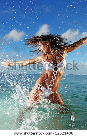 gorgeous sexy woman splashing in ocean - stock photo