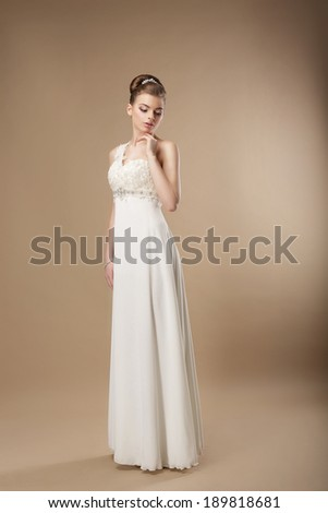 Gorgeous Shapely Woman in Long Smooth White Dress - stock photo