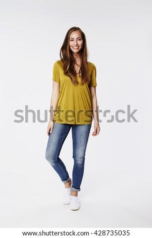 Gorgeous smile on brunette in studio - stock photo