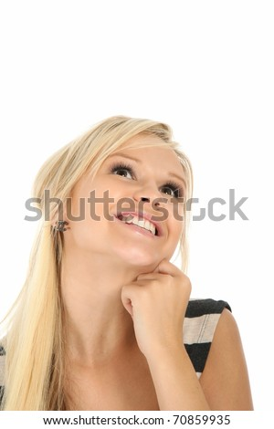 Gorgeous smiling blonde woman looking upwards and smiling - stock photo