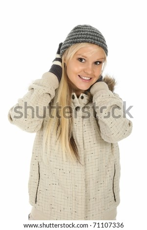 Gorgeous smiling young lady dressed in winter clothes and gloves - stock photo