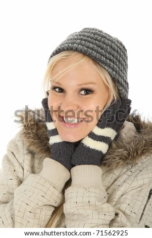 Gorgeous smiling young lady dressed in winter hat and gloves - stock photo