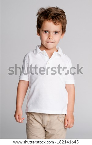 Gorgeous studio portrait of handsome toddler boy. - stock photo