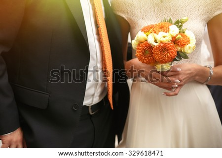 gorgeous stylish elegant bride and groom holding colorful bouquet - stock photo