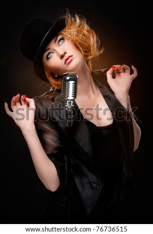 Gorgeous stylish redhead woman with retro microphone - stock photo