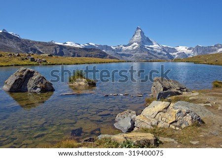 gorgeous summer landscape with mountain lake in the Swiss Alps - stock photo