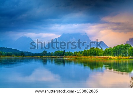 Gorgeous Sunrise, reflection in the water - Grand Tetons Oxbow Point - stock photo