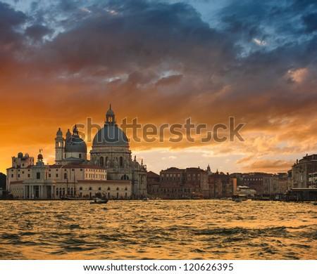 Gorgeous sunset over Grand Canal and Basilica Santa Maria della Salute, Venice, Italy - stock photo