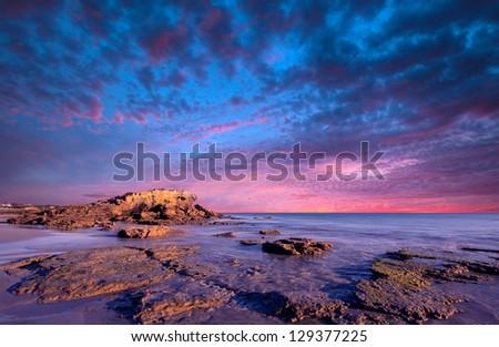 Gorgeous sunset over rocks - stock photo