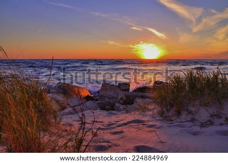 Gorgeous sunset over the Lake Michigan horizon. Ludington State Park. Ludington, Michigan. - stock photo