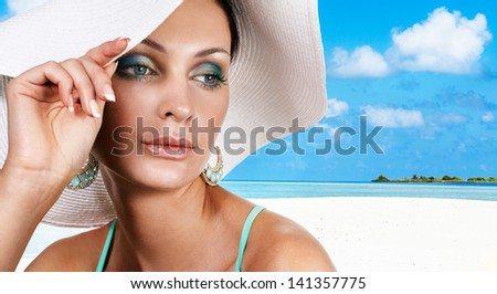Gorgeous tanned woman on summer vacation - stock photo
