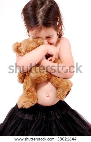 gorgeous toddler girl cuddling her teddy bear - stock photo