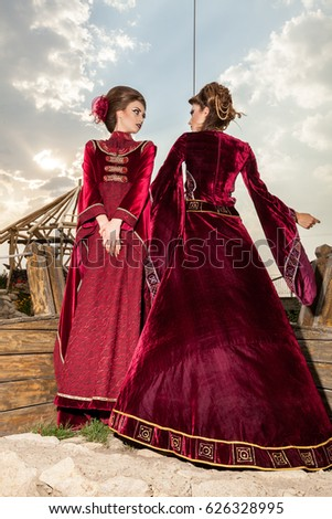 Gorgeous two ladies in vintage clothes on a boat. Luxury and glamour