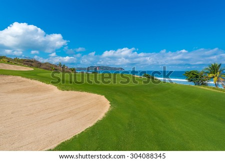 Gorgeous view at the beautiful golf course with sand bunker at the ocean side.