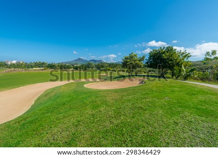 Gorgeous view at the beautiful golf course with sand bunkers.