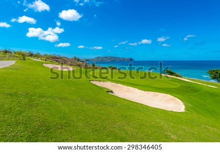Gorgeous view at the golf course with sand bunkers at the ocean side. - stock photo