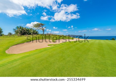 Gorgeous view at the golf course with sand bunkers at the ocean side. Luxury Mexican resort. - stock photo