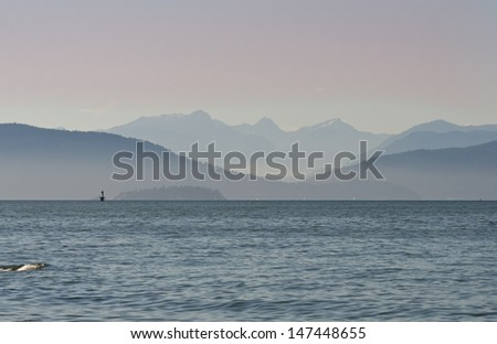 Gorgeous view at the marine scenery. Ocean inlet  with the mountains and hills as a great background. Vancouver, Canada. - stock photo