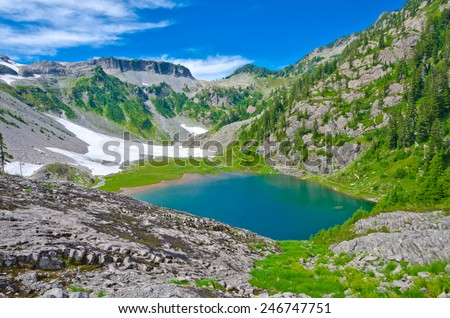 Gorgeous view at the mountain valley with lakes, snow and wilderness. North America. - stock photo