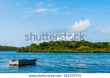 gorgeous view of an old boat at Mercers Creek Bay, Antigua. - stock photo