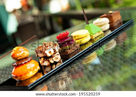 Gorgeous view of different cakes and biscuits, served in outdoors - stock photo