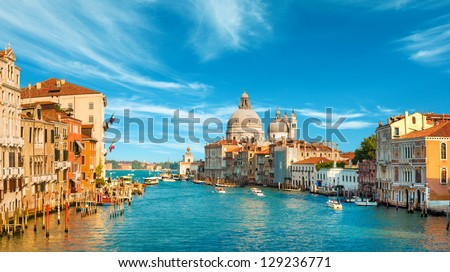 Gorgeous view of the Grand Canal and Basilica Santa Maria della Salute during sunset with interesting clouds, Venice, Italy - stock photo