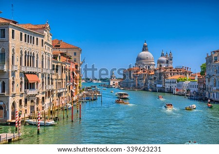 Gorgeous view of the Grand Canal and Basilica Santa Maria della Salute during sunset with interesting clouds, Venice, Italy, HDR - stock photo