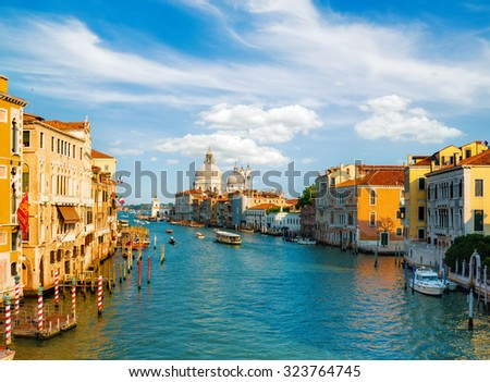 Gorgeous view of the Grand Canal and Basilica Santa Maria della Salute during sunset with beautiful clouds, Venice, Italy - stock photo