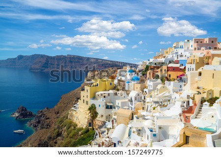 Gorgeous view of the Oia village and caldera under dramatic clouds, Oia, Santorini island, Greece - stock photo