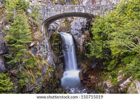 Gorgeous waterfall with a bridge  - stock photo