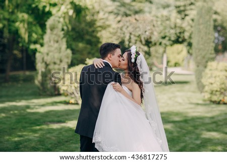 gorgeous wedding and beautiful couple of young people in the summer - stock photo