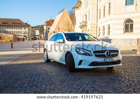 Gorgeous white Mercedes parked on the street in Zurich, Switzerland - stock photo