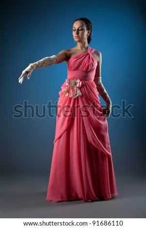 Gorgeous woman dressed in rose fashion cloth
