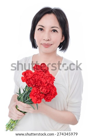 gorgeous woman holding bouquet of fresh red carnation - stock photo
