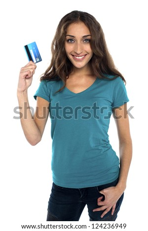 Gorgeous woman holding credit card. Lets go shopping...
