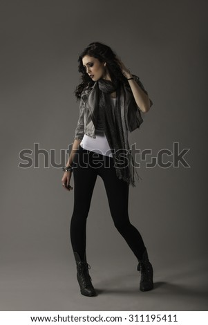 Gorgeous woman in alternative style outfit  - stock photo