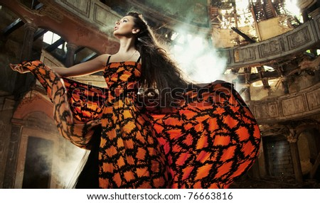 Gorgeous woman in beautiful dress - stock photo