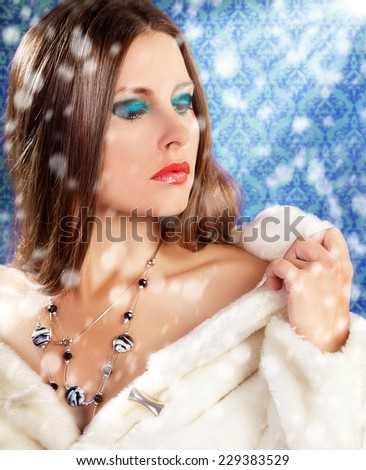 Gorgeous woman in fur on vintage background with rays. Cosmetic and skincare. Fashion glamour style photography. Toned skin. Expensive luxury jewellery. Christmas theme - stock photo