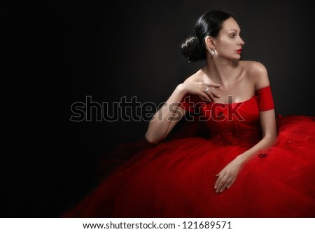 gorgeous woman in red evening dress on black - stock photo