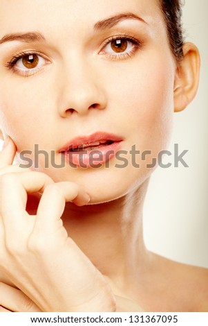 Gorgeous woman looking at camera over white background - stock photo
