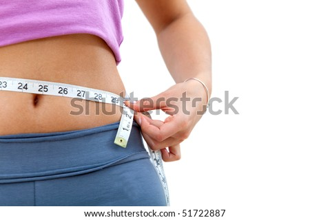 Gorgeous woman measuring her waist isolated over white - stock photo