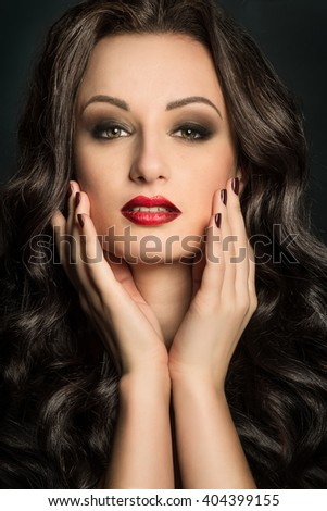 Gorgeous woman portrait with makeup red lips and smoky eyes