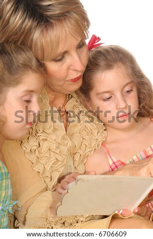 Gorgeous woman reading to her Grandchildren vertical - stock photo