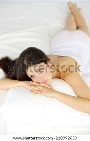 Gorgeous woman sad in bed feeling lonely
