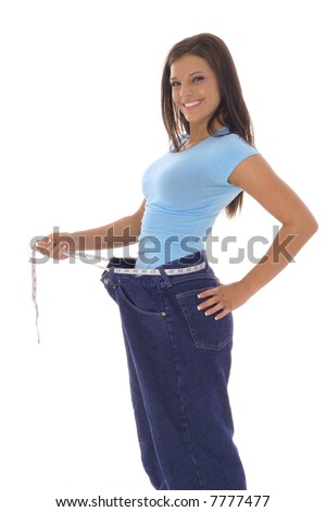 gorgeous woman showing off her weight loss - stock photo