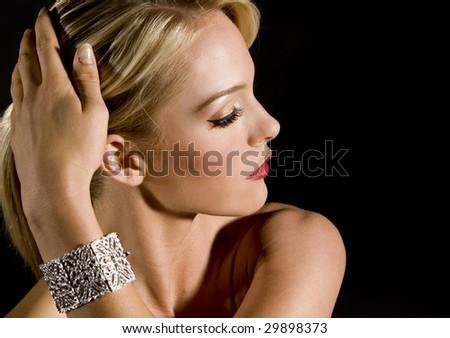 Gorgeous woman wearing a diamond bracelet - stock photo