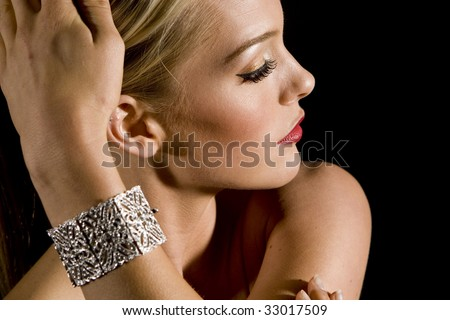 Gorgeous woman wearing a diamond bracelet - stock photo