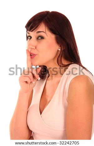 Gorgeous woman with her finger over her lips in be silent sign