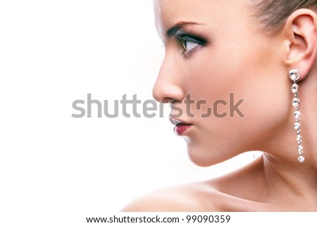 Gorgeous woman with long earrings on white background - stock photo
